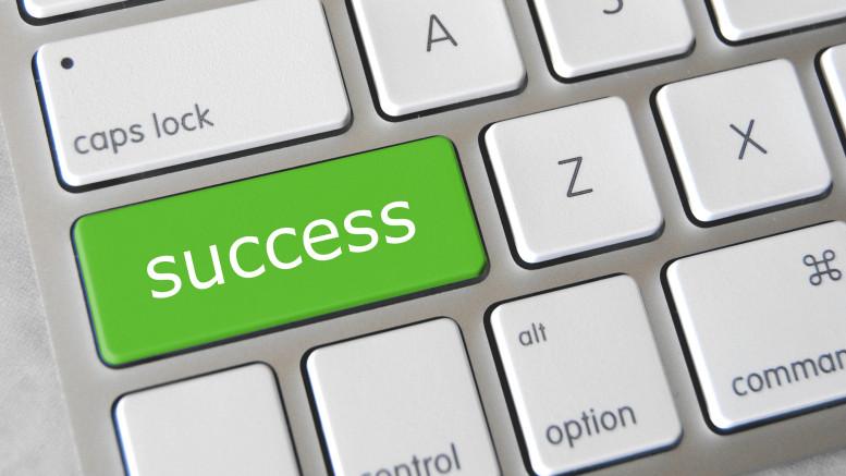 """Tangentbord med en tangent märkt """"success"""""""