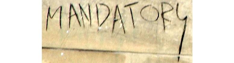 """Ordet """"mandatory"""" målat på en vägg."""